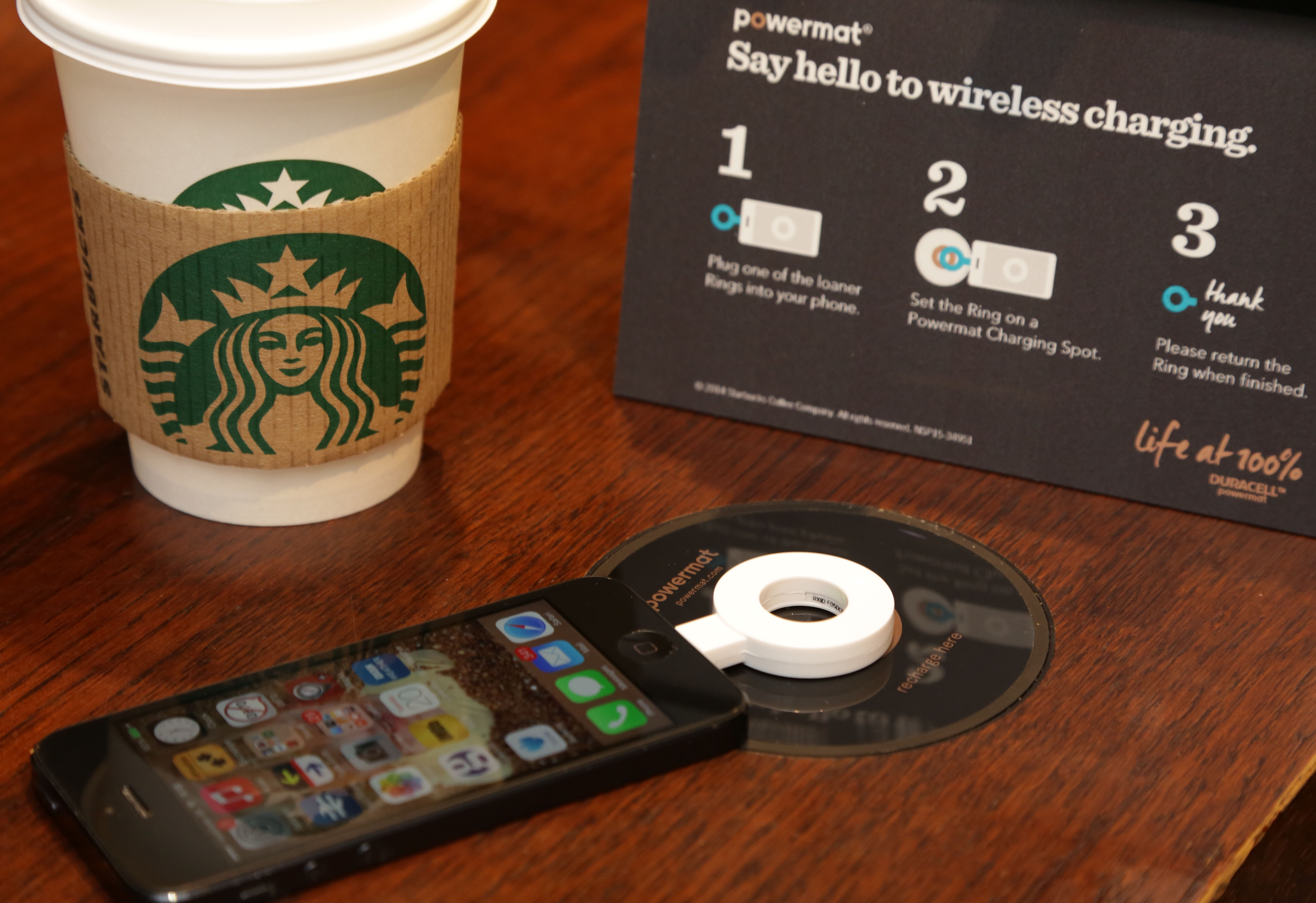 A wireless charging Powermat in Starbucks